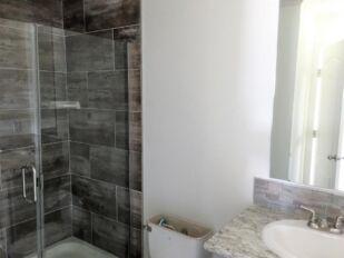 Master Bathroom with Walk-In Tile Shower