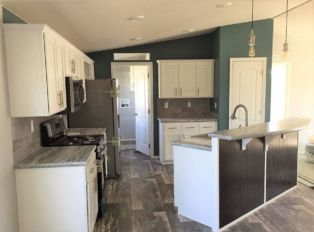 Kitchen Island with Stainless Farmhouse Sink