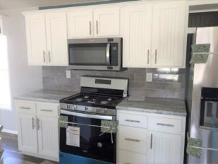 Kitchen Stainless Steel Appliances includes Space Saver Microwave, Gas Range, Side-by-Side Refrigerator