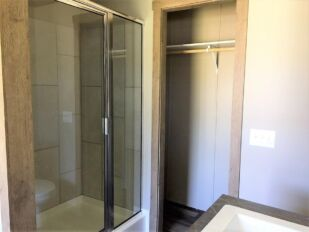 Master Bath with Walk-in Shower and Walk-in Closet